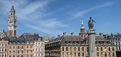 View in Grand Place in the historical city of Lille France. The view includes the Column of the Goddess Vieille Bourse and the Chamber of Commerce and Industry. poster
