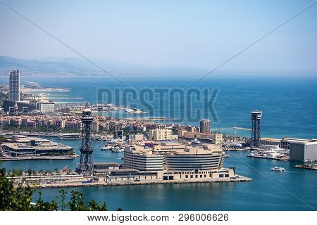 Barcelona, Aerial View Of Port Vell From Montjuic Hill With The Mediterranean Sea And Coastline. Cat
