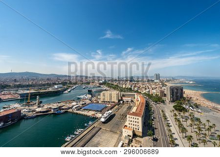 Aerial View Of Barcelona From The Cableway To The Montjuic Hill With The Barceloneta Beach And Port