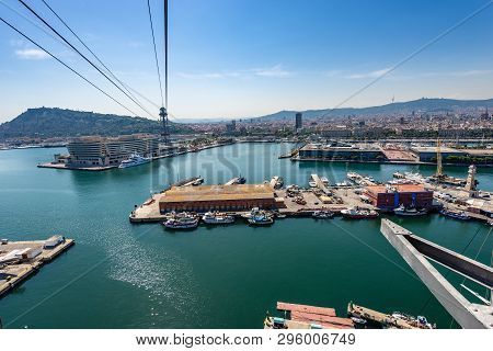 Cityscape Of Barcelona With The Port Vell. Aerial View From The Cable Car That Connects La Barcelone