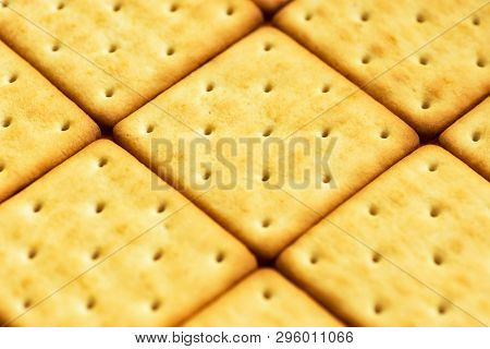 Baking Culinary Creative Food Background. Pattern From Savory Cheese Crackers With Golden Crust. Bre