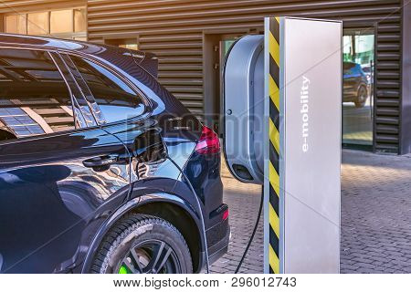 Charging An Electric Car At A Car Repair Shop Service Garage. Refueling For Electric Cars E-mobility