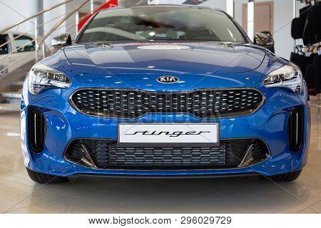 Russia, Izhevsk - April 4, 2019: Showroom Kia. New Sports Car Stinger In Dealer Showroom.