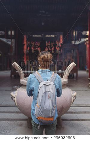 Traveler At Thien Hau Pagoda, Dedicated To The Chinese Sea Goddess Mazu , In Cholon, The Chinatown A