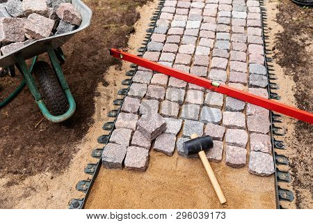 Landscaping And Garden Services - Granite Cobblestone Walkway Construction