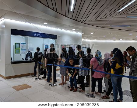 Jakarta, Indonesia - April 7, 2019: Crowd Of People Standing In Line To Buy Ticket Fare Of Mrt Jakar