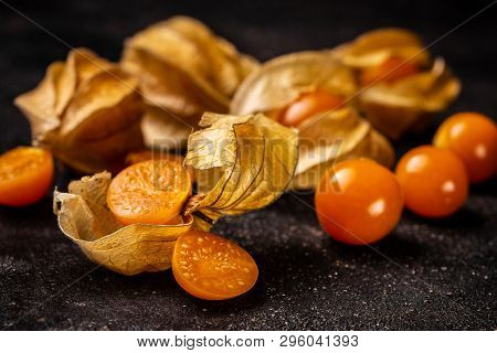 Cape Gooseberry (Physalis Peruviana) or poha with calyx on black board poster