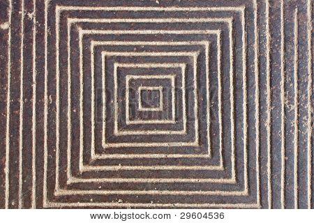diamond-shaped pattern on the metal iron