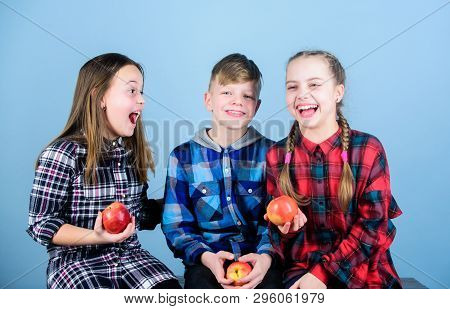 Health Is Our Friend. Cute Little Children Holding Red Apples. Natural Food Is Good For Childrens He