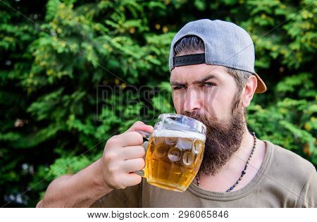 Beer and ale concept. Man relaxing enjoying beer hot summer day. Quench thirst. Alcohol drink and bar. Hipster brutal bearded man hold mug cold fresh beer. Craft beer is young, urban and fashionable poster