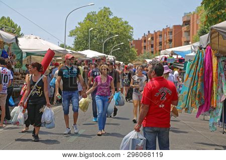 Rome, Italy - June 29, 2014: People Browsing For Cheap Clothing At Porta Portese Sunday Flea Market