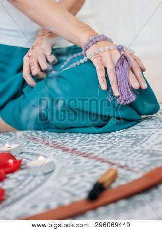 Woman With Lilac Mala Beads On Her Hands Henna Mehendi