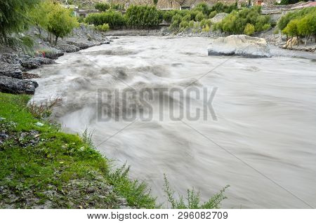 Fast, Affluent And Muddy Mountain Nepal River Near Jomsom Village