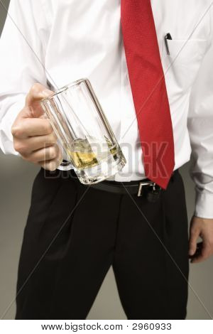 A man dressed in business attire holding a mug with beer poster