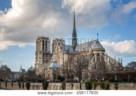 Caption/Description: Notre Dame Cathedral in Paris. Springtime view. of the side elevation with spire and rear flying butresses, taken from across the river Seine.
