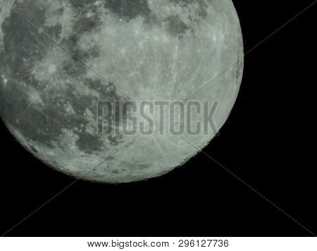 A Full Moon In The Starry Night Sky
