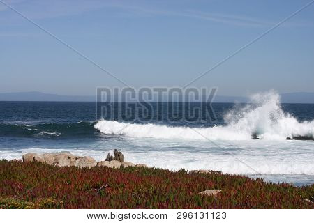 This Is An Image Of A High Spray Waive Taken Along The Shoreline Of Pacific Grove, California In Ful