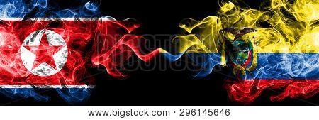 North Korea Vs Ecuador, Ecuadorian Smoky Mystic Flags Placed Side By Side. Thick Colored Silky Smoke