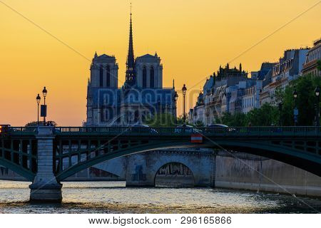 Notre dame de Paris cathedral under a warm summer sunset