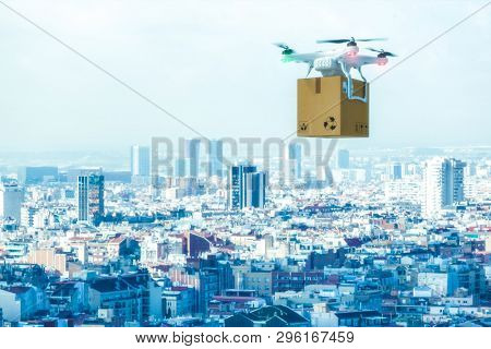Modern drone carries a package and flies over a city. Concept of transport and automated shipping. 3d image render.
