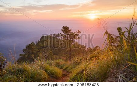 Gold Sunset And Purple Light Phu Nom At Phu Langka National Park Thailand With Fog On Sky Normal. Ph