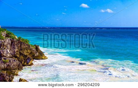 The Rocky Shore Is Covered With Vegetation On The Shore Of The Paradise Blue Lagoon Of The Warm Trop