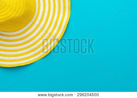Top View Of Yellow Hat Close-up Over Blue Background. Minimalist Photo Of Striped Retro Hat With Cop