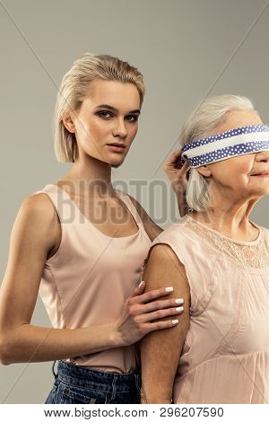 Beautiful Young Woman Standing Behind Her Mother
