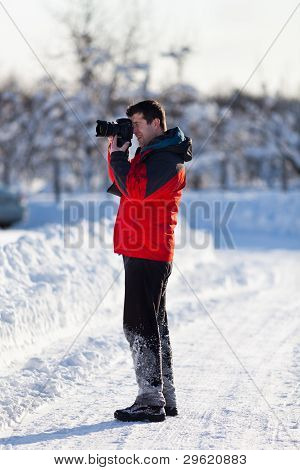 Tourist With Camera In The Winter