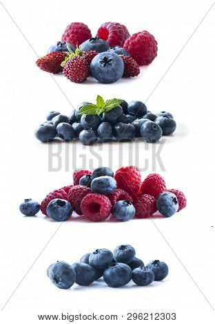 Pink And Blue Berries. Berries Isolated On White Background. Ripe Blueberries, Wild Strawberries, Ra