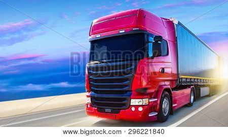 The Red Truck On The Road . Truck Transport Container . Commercial Transport .
