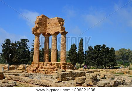 Temple Of Dioscuri (castor And Pollux) With Agrigento Town In The Background. Famous Ancient Ruins I
