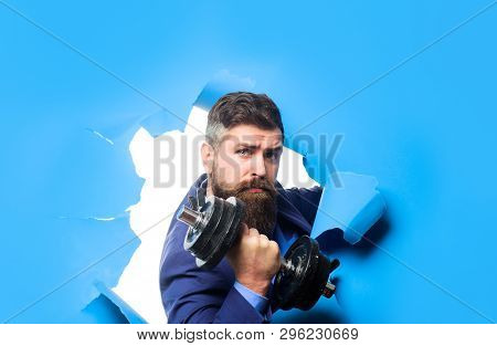 Through Paper. Bearded Man With Dumbbell Looking Through Paper Hole. Power. Strength. Bearded Man Th