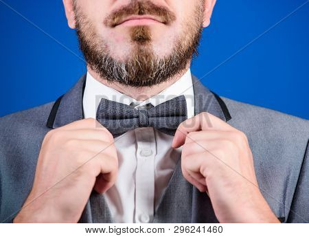 Mr. Perfection. Man Adjusting Bow Tie. Business In Modern Life. Illusionist. Bride Groom Ready For W