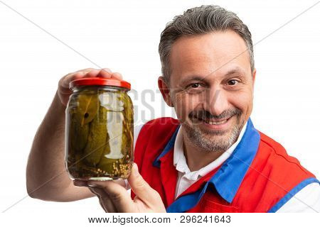Trustworthy supermarket or hypermarket male employee presenting jar of pickles isolated on white studio background poster