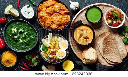 Indian Cuisine Dishes: Tikka Masala, Dal, Paneer, Samosa, Chapati, Chutney, Spices. Indian Food On D