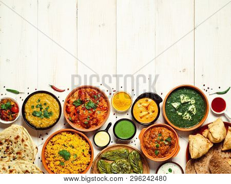 Indian Cuisine Dishes: Tikka Masala, Dal, Paneer, Samosa, Chapati, Chutney, Spices. Indian Food On W