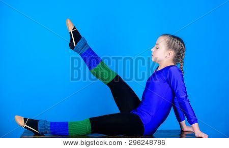 Practicing gymnastics hard before performance. Rhythmic gymnastics sport combines elements ballet dance. Girl little gymnast sports leotard. Physical education and gymnastics. Flexible healthy body poster