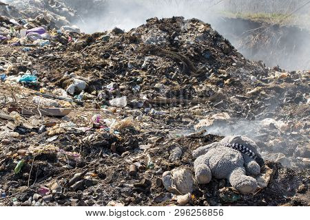 Plastic Bags And Bottles In A Landfill. Unauthorized Release Of Garbage, Pollution Of Nature. The Co