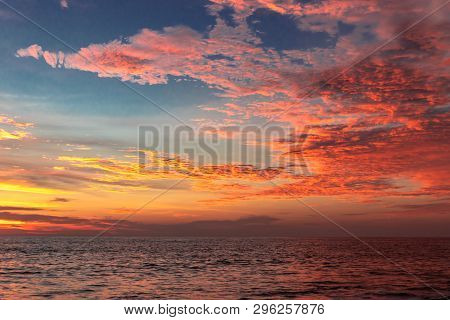 Sunset View Of Clouds Above Sea Surface At Alleppey Beach India. Cloud Image In Sun Orange Rays.