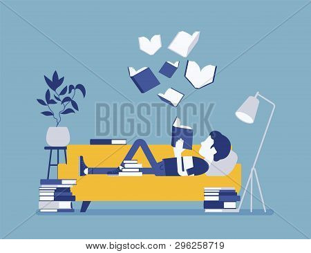 Male Book Reader. Boy Reads For Pleasure Lying On Sofa, Enjoys Free Time Around Literary Pages, Open