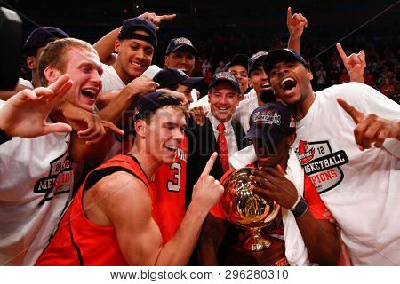 NEW YORK-MAR 10: Louisville Cardinals head coach Rick Pitino & players celebrate winning the Big East Tournament against the Cincinnati Bearcats on March 10, 2012 at Madison Square Garden in New York.