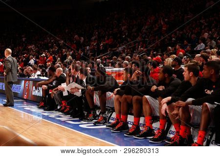 NEW YORK - MAR 10: Cincinnati Bearcats react on the bench against the Louisville Cardinals during the Big East Tournament on March 10, 2012 at Madison Square Garden in New York City.