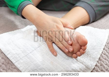 Child Rubs The White Powder Into The Foot. Foot Skin Hygiene.