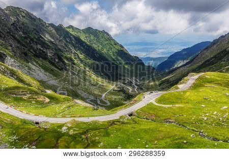Perfect Sunny Landscape. Fantastic Mountain Valley. View On Beautiful Mountain Road At Sunrise In Su
