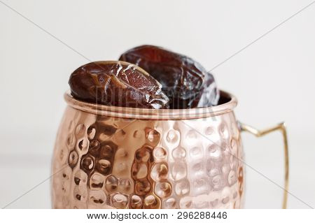 Sweet Dried Dates In A Brass Mug. Traditional Food During Holy Ramadan Month In Middle East