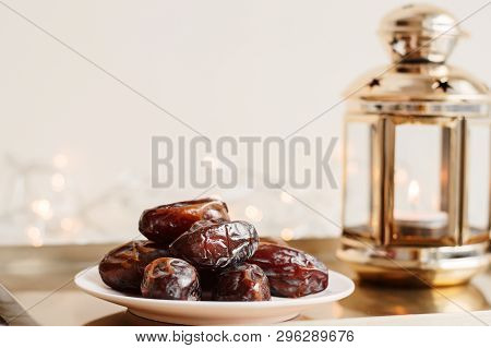 Serving Of Dried Dates And Gold Colored Lantern On Metal Tray, Festive Lights As Background. Ramadan