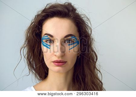 young girl with long hair with blue kinesiotape poster