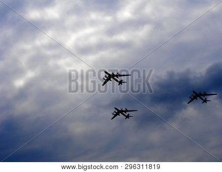 Silhouettes Flying Russian Tu-95 Bombers Against The Sky.