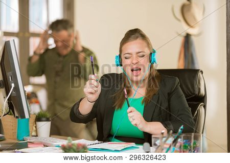 Young Professional Woman Singing Loudly Enough To Annoy A Colleague